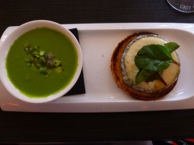 Green pea soup cold with cream and goat cheese on toast