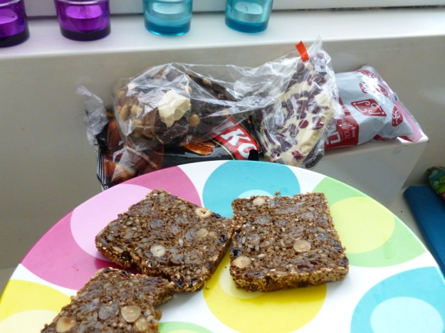 Nut and fruit chocolate bark, salty licorice (drope) and bread