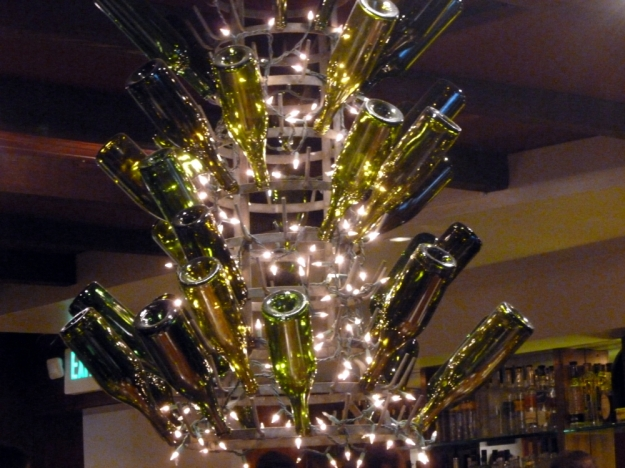 A beautiful chandelier made with wine bottles.