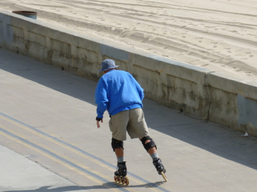 All day, every day, this man roller-bladed.