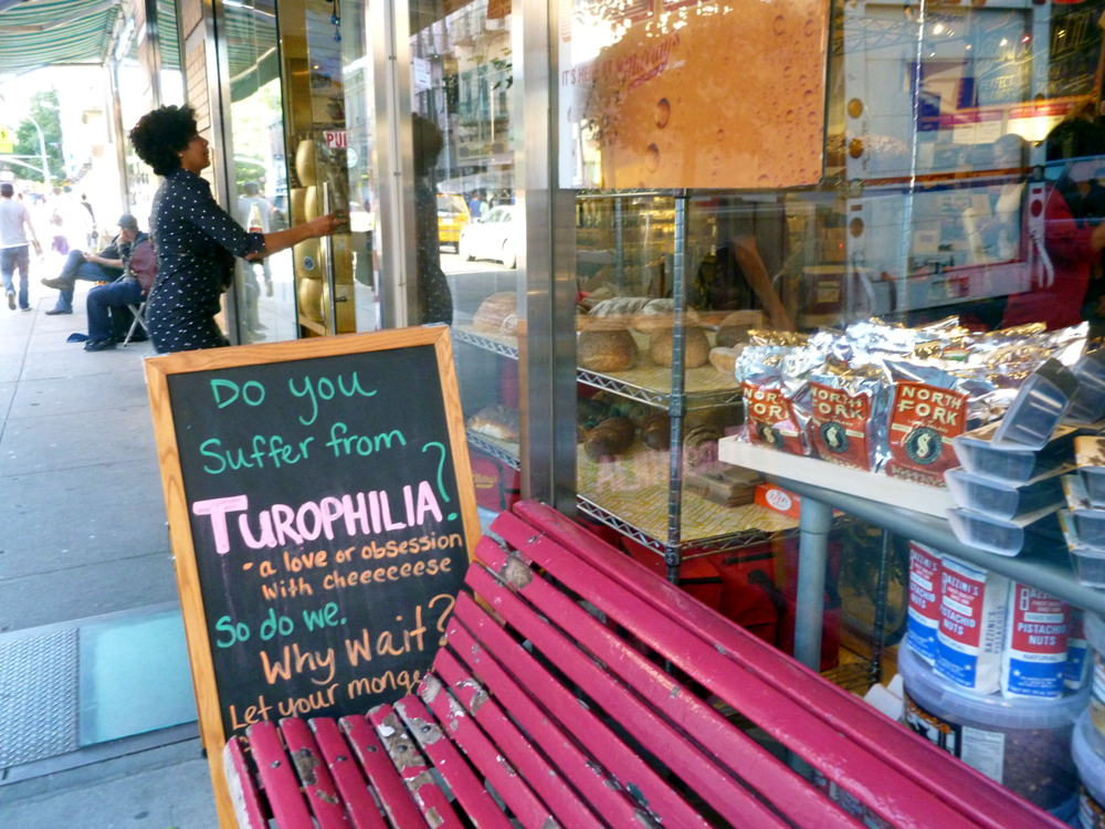 Turophilia (excessive love of cheese) Greenwich Village, sign outside the cheese shop