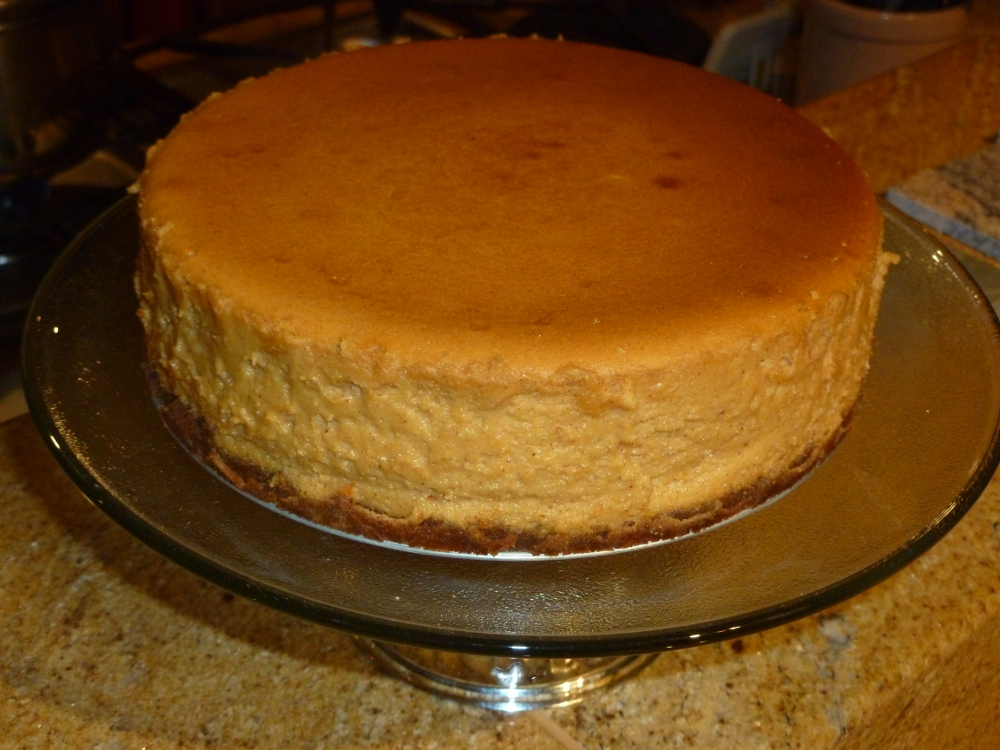 Sweet potato maple cream cheesecake with a graham cracker and pecan crust