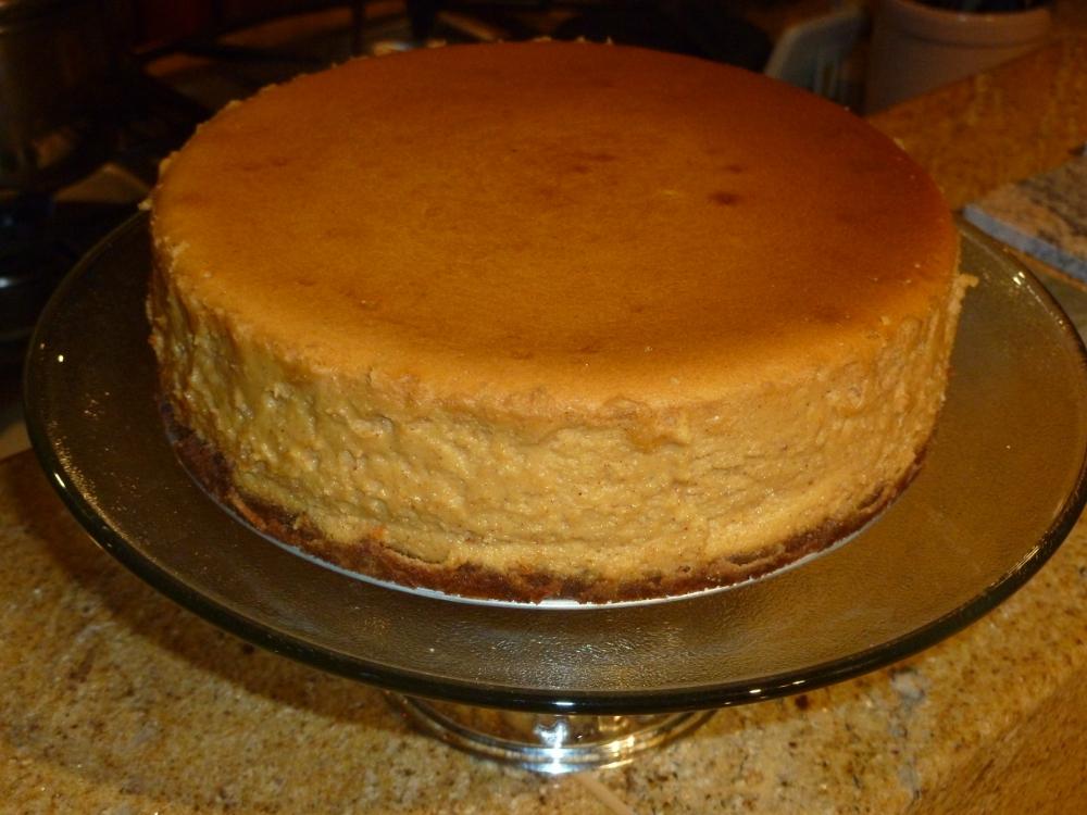 Sweet potato maple cream cheesecake with a graham cracker and pecan crust