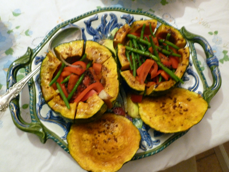Kabocha squash stuffed with veggies and glazed with a sauce of Worcestershire, soy sauce, sherry, cumin, cayenne and butter and olive oil