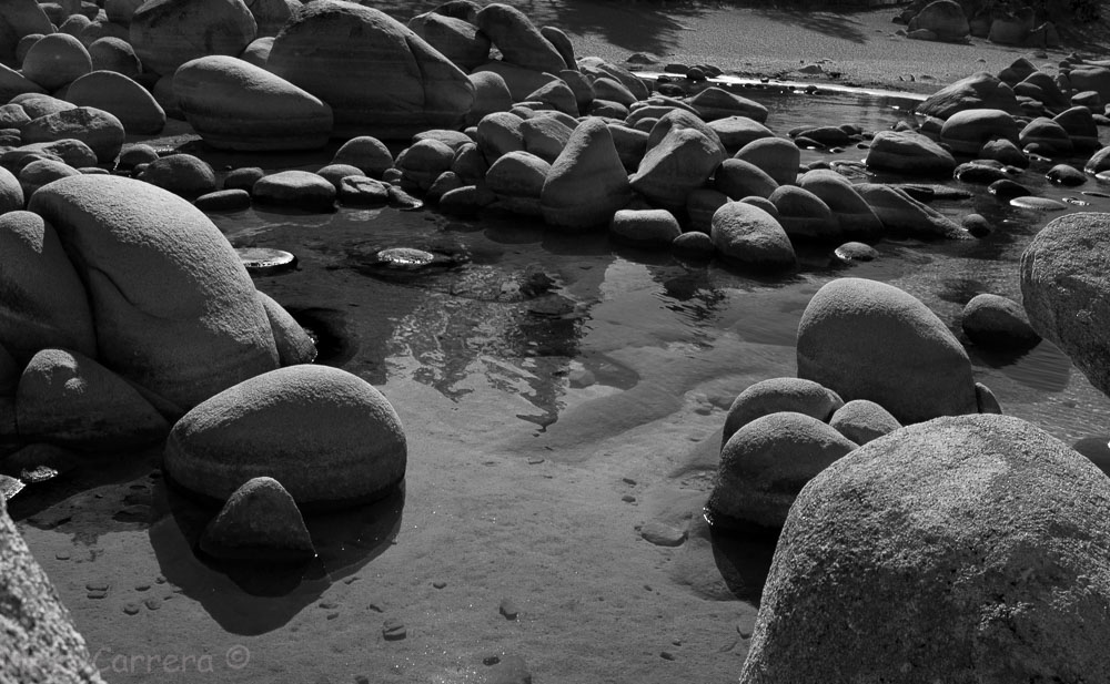 A black and white image of boulders in Lake Tahoe, Sand Harblr